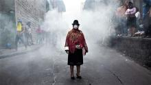 An indigenous woman wears a mask during a protest in Quito